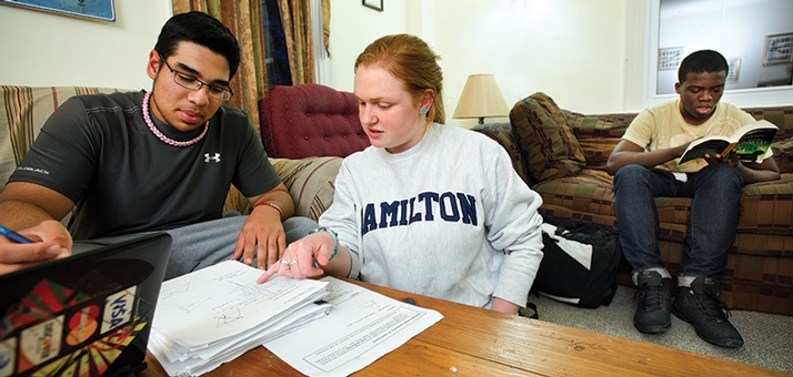 Clinton sophomore Lenny Ortiz gets assistance from Hamilton tutor Sarah Andrews '14.