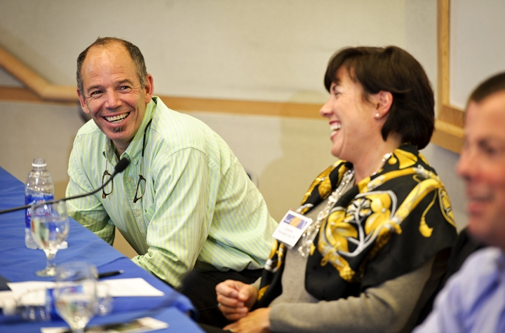 Marc Randolph '81 and Gretchen Morrison Grad '85 share a laugh during a panel discussion.