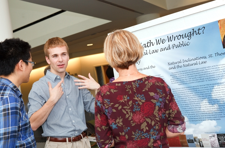 Levitt Research Fellow Thomas Cheeseman '12 discusses his research findings in a summer research poster session.