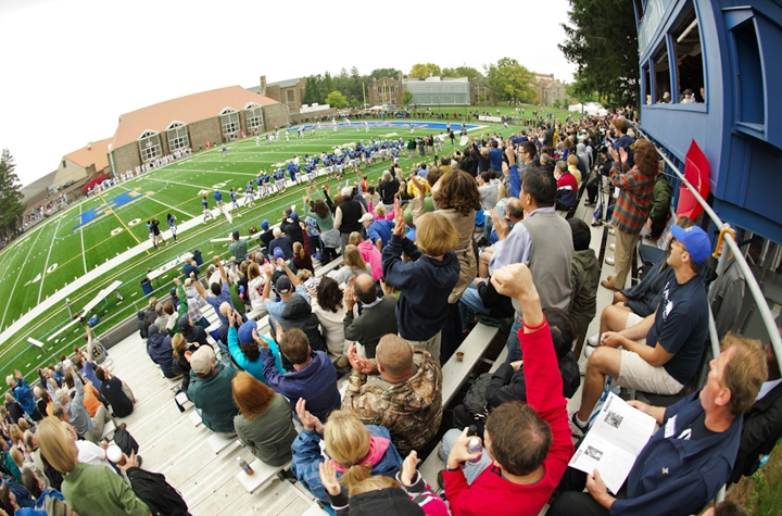 Cheering fans filled the stands as the football team defeated Tufts 24-16 in its season opener.