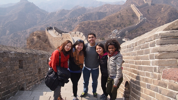 Students in the Associated Colleges in China Program pose for a photo on the Great Wall of China.