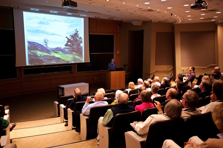 Alumni enjoy a slideshow during the Class of 1964 Alumni College: Monhegan Island Art.<br />Photo: Rebecca L. Sheets