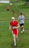 Mathematics professor Sally Cockburn on the cross-country course, followed by Daniel Kamenetsky '11.