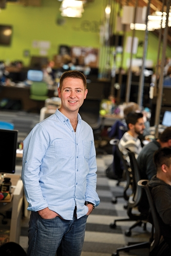 """Serial entrepreneur"" Mark Kasdorf '06, shown here at the Intrepid headquarters, has launched four companies since he graduated from Hamilton."