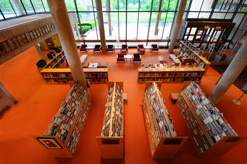 Burke Library's orange carpet and general first floor layout was a constant for over forty years, providing a sense of nostalgia to those returning to the Hill.