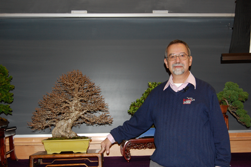 William N. Valavanis, founder of the International Bonsai Arboretum in Rochester. Next to Bill is his Korean Hornbeam, Carpinus coreana, displaying a beautiful winter silhouette.