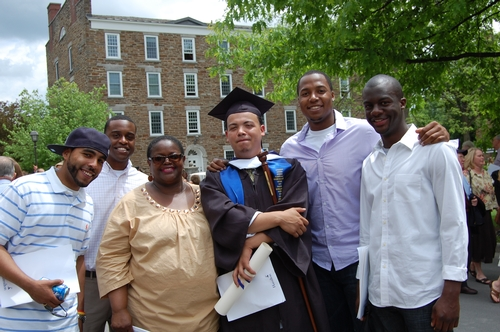 Ms Breland with Roy Rivera and previous grads