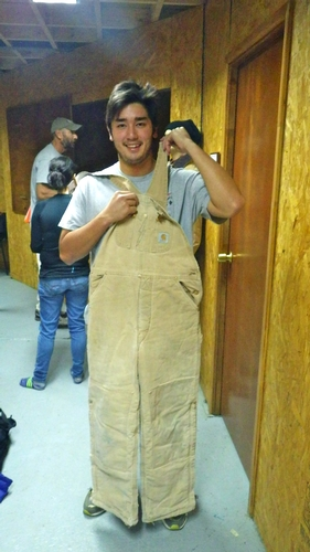 Alex Hare '14 holds up a pair of insulated Carhart Overalls. This is one example of the issued Cold Weather Gear that we received prior to our deployment.
