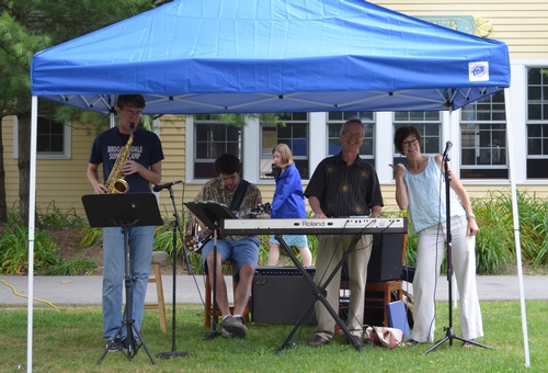 Monk Rowe, Amy James and other talented musicians provided music during a Summer Community Lunch.