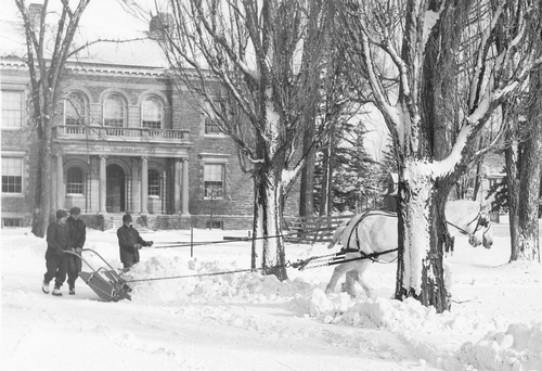 Snow removal in the East Quad in front of Truax building where Burke now stands.