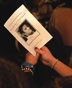 A mourner holds a memorial program for Alex Paganelli '12 during a Jan. 31 service at the Chapel.