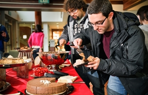 Jason Mariasis '12 helps himself to chocolate moose and chocolate cake.