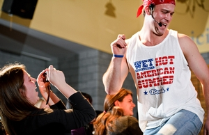 A spectator videos contestant John Whitney '12 leading a dance routine.