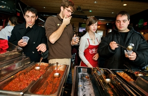 From left to right, Steve Lucchetti '12, Ben Swett '14, contestant Kelsey Brow '12 and Richard Karrat '12 try the different chili before voting for their favorite.