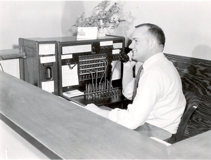 Don Sebya at the College switchboard