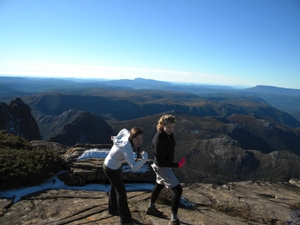 Figure 4 - Madison Beres '15 and Nora Boylan '15 celebrate as they reach the summit of Cradle Mountain.