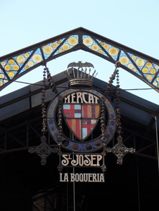 "The entrance to the Boquería market, officially ""El Mercat de Sant Josep"" -- a 19th century ""moderniste"" structure that is the city's biggest and most bustling food mecca."