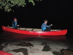 Group leaders Kevin Rowe '10 and Corinne Bancroft '10 try a little night canoeing.