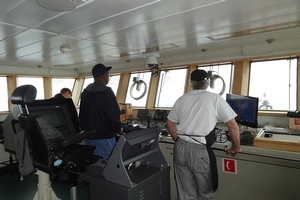 Ernest, the Chief-Mate at the helm, guides us through the Gerlache Strait.