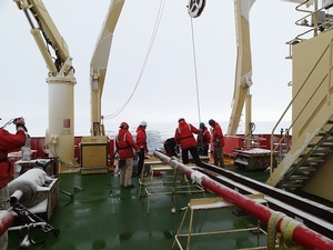The Marine techs getting the Kasten core aboard the ship.