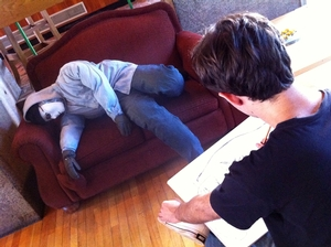 A student practices drawing techniques as his dummy reclines.