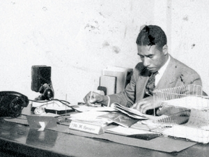 Morteza Sprague '29 in his office at Tuskegee Institute in the 1930s (above) and with his Hamilton Class (top). A street at what is now Tuskegee University bears Sprague's name.