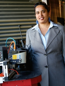 Mary Bernardine Dias '98, working at Carnegie Mellon University's Robotics Lab in Doha, Qatar, demonstrates an enhanced Pioneer 3AT robot used in experiments involving coordinated human-robot delivery of post-disaster aid.