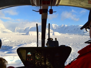 Flying over sea ice and icebergs in Flandres Bay.