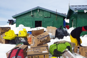 This photo shows only some of the gear we helped transport to the station. On the left you can see a peer shoveling a huge mound of snow in front of the scientists living quarters. The building on the right is devoted entirely to food storage!
