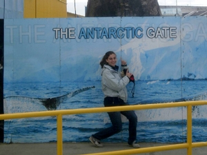 "Deanna Nappi '15 shows her excitement for the trip at the pier in Punta Arenas, an area commonly referred to as ""The Antarctic Gate""."