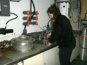 Katy Smith '13 collecting a sea water sample from the Drake Passage. Samples will be collected every 6 hours in order to record changes in diatom content.