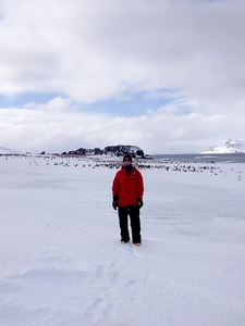 Garrett Akie '12 with penguin colony just a few hundred yards from the Copacabana field station on King George Island.