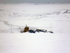 View of Palmer Station and the Laurence M. Gould from the top of a glacier on Anvers Island.  The Arthur Harbor is still full of pack ice blown in from the southwest.