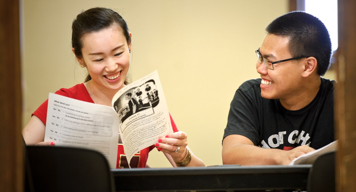 Tanapat (Ice) Treyanurak '17, right, tutors immigrant Lucy Wang in ESL at BOCES Utica Access site.