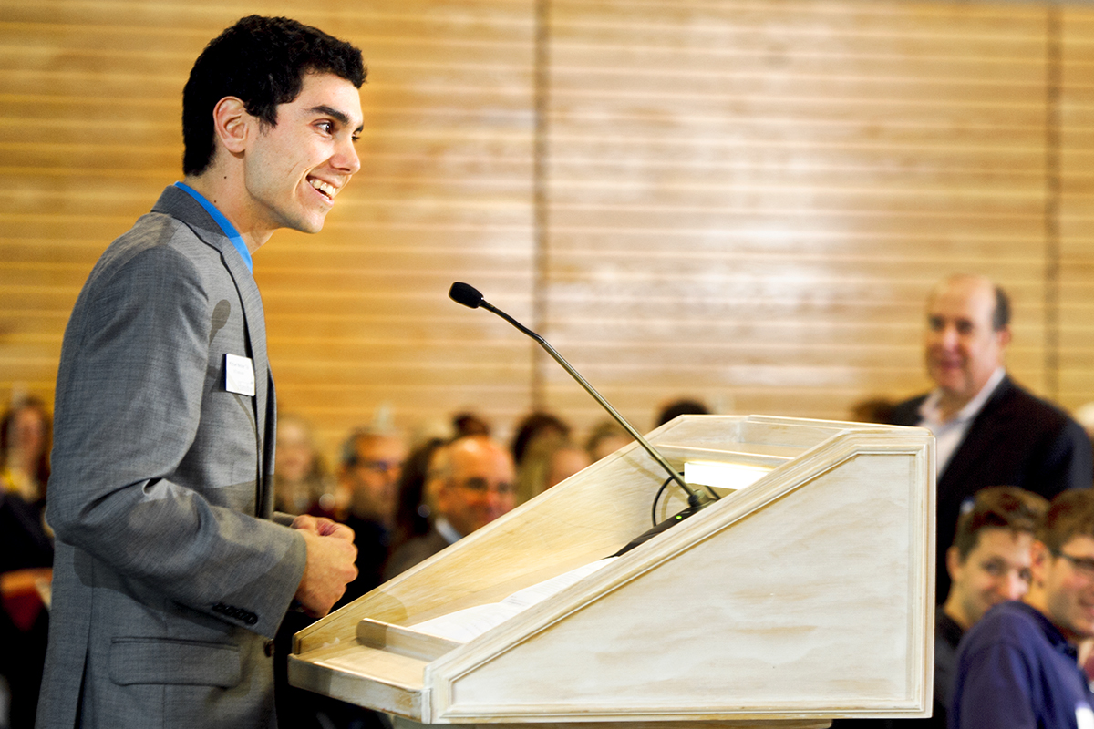 Michael Nelson '16 speaks to guests during the annual Comstock Luncheon.
