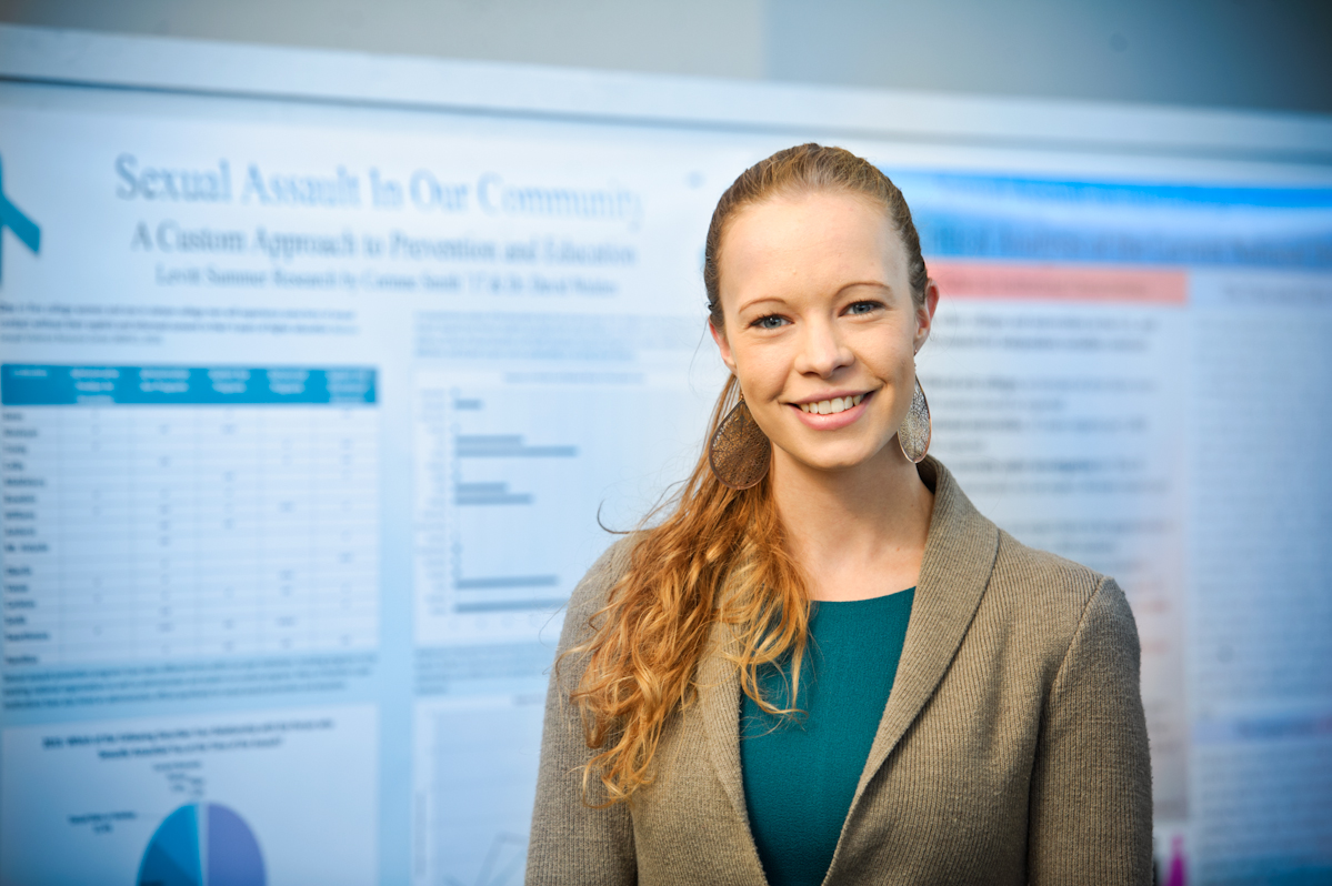 Corinne Smith presents her research during a poster session on campus.