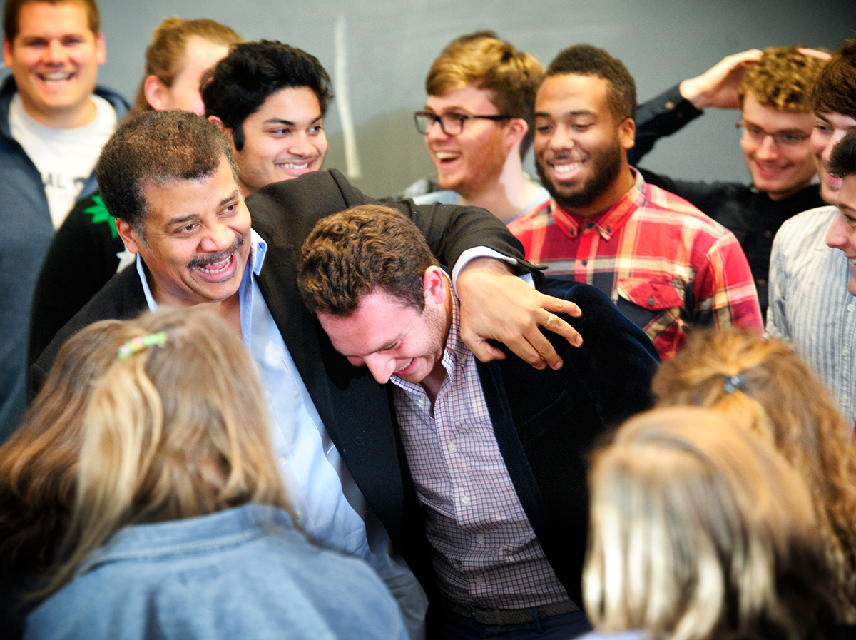 Neil deGrasse Tyson shares a laugh with students after he spoke with them in Taylor Science Center.