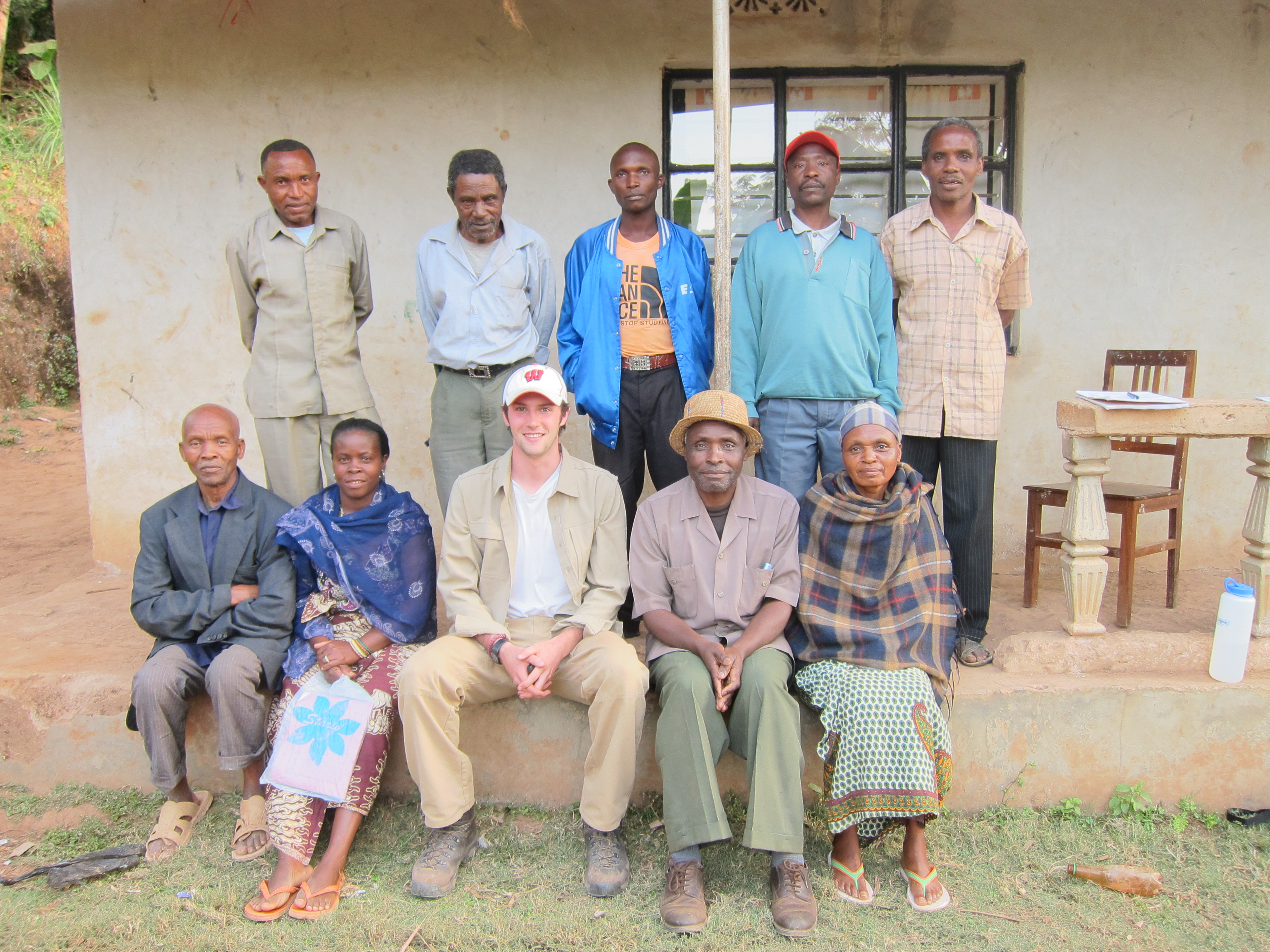 Eren Shultz '15 in the Pare Mountains, posing with the board members of the Gonja Sub-Kume Water Cooperative.