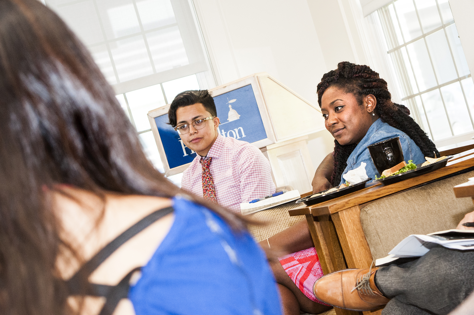 Alicia Garza, right, meets with students in the Days-Massolo Center.