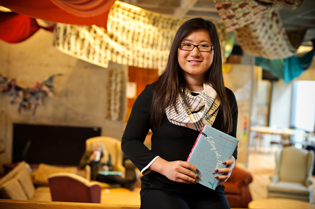 Amy Zhang '18 poses with her book <em>Falling Into Place</em>.