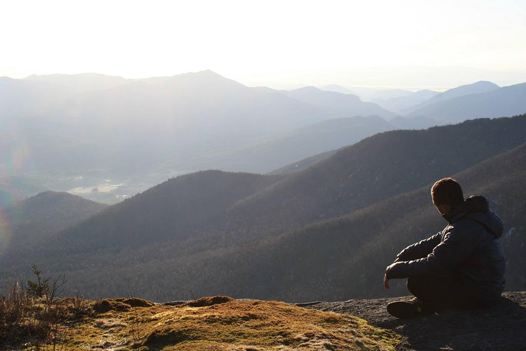 Purujith Gautam '16 takes in the sunrise from Cascade Mountain in the Adirondacks.