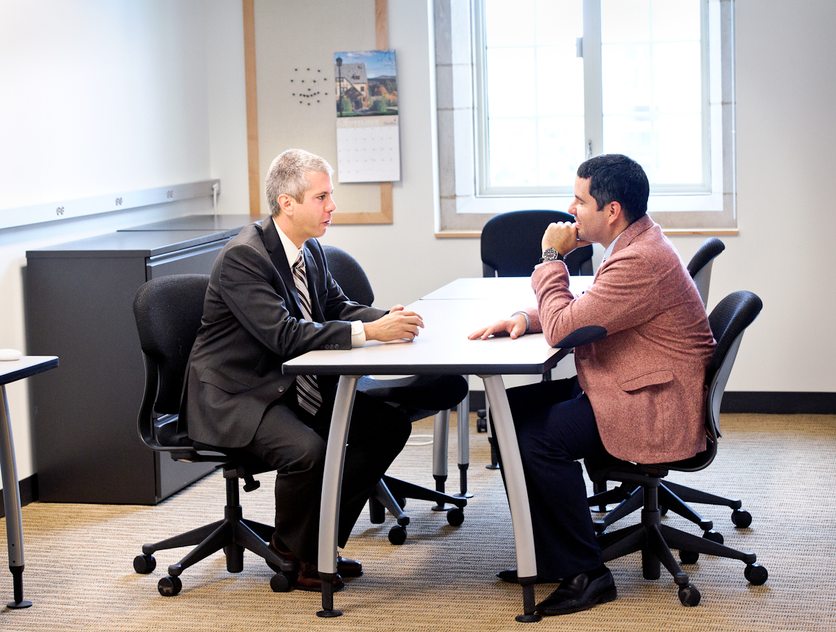 Assemblyman Anthony Brindisi, left, meets with Assistant Professor of Psychology Jose Causadias.