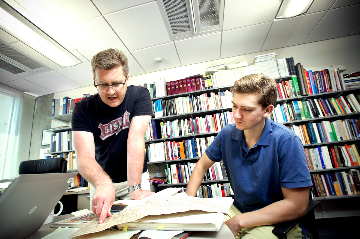 Matt Currier '16, right, reviews documents with Assistant Professor of History John Eldevik.