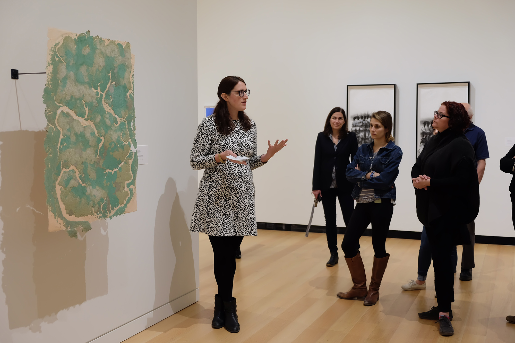 """Bridget Donlon, curator of """"Pure Pulp: Contemporary Artists Working in Paper at Dieu Donné,"""" leads a tour of the Wellin exhibit."""