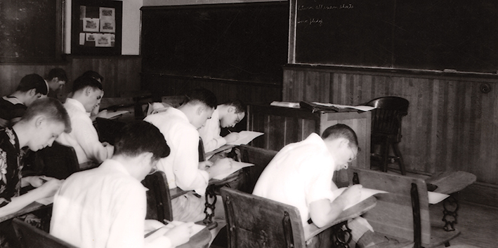 Students take a final exam in June 1950, with no proctor or professor in the classroom. (PHOTO BY GEORGE S. TILLMAN)
