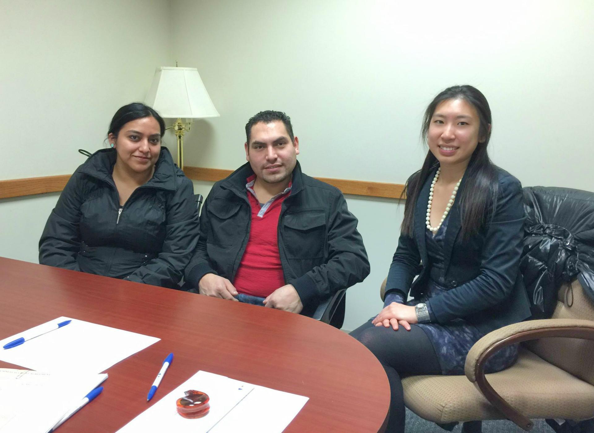 Lisa Yang '17, right, with Hamilton Microfinance loan recipient Lourdes Alvarez and her husband.