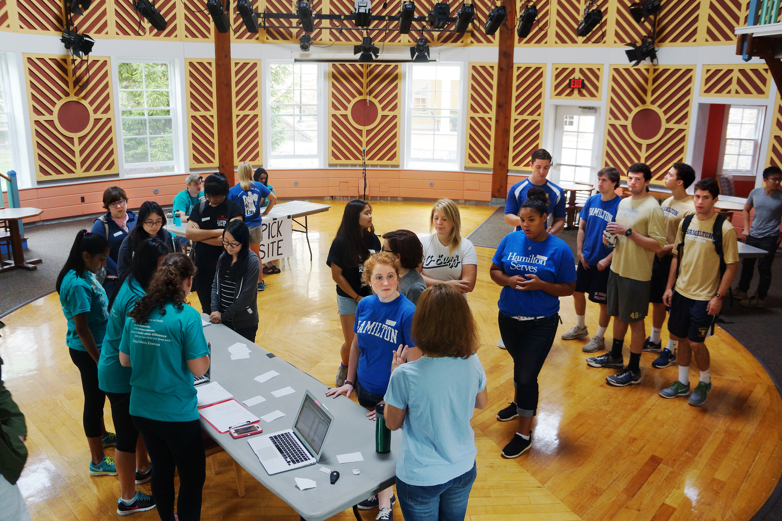 Students gather in the Events Barn to sign up for Make a Difference Day volunteer opportunities.