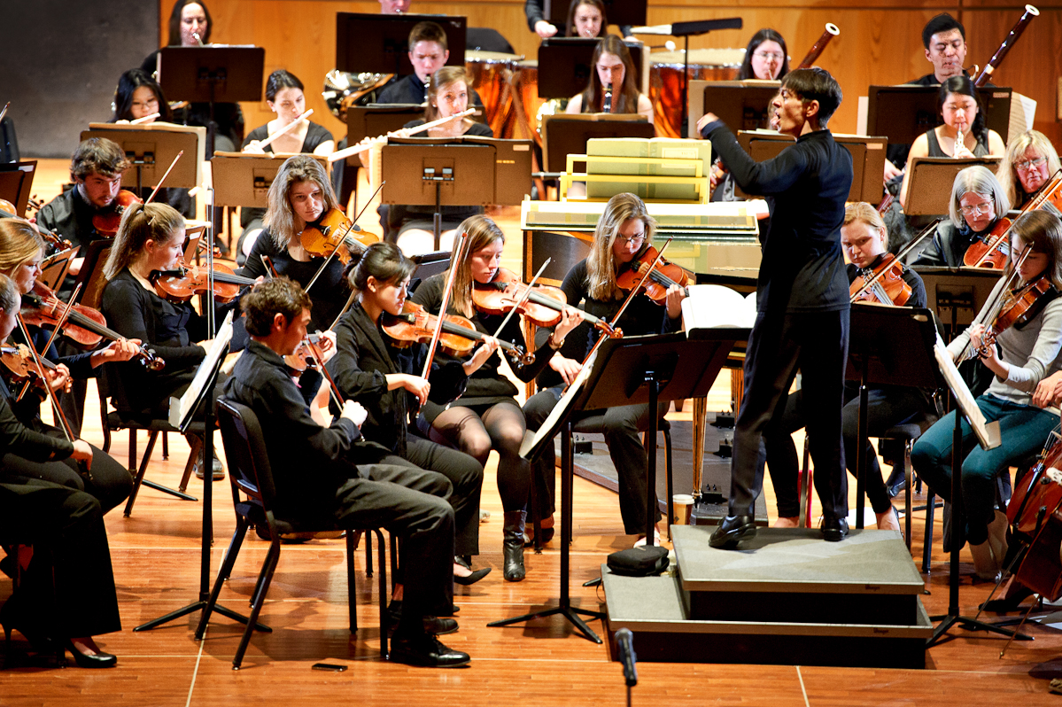 The Hamilton College Orchestra, conducted by Heather Buchman, practices in Wellin Hall.