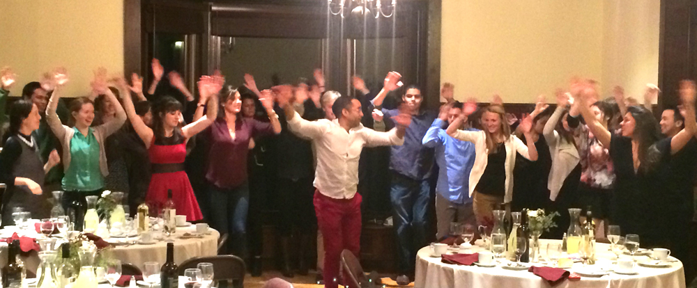 Dance instructor Roberto Luis Perez from Syracuse leads the Hispanic Studies majors in a dance.