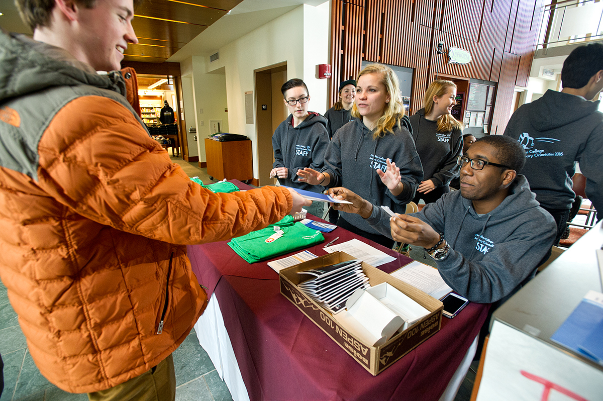 January admit Rowan Myers '19 checks in for Orientation with Eliana Zupcich '18, Katherine Spano '18 and David Dacres '18 at the Sadove Student Center.